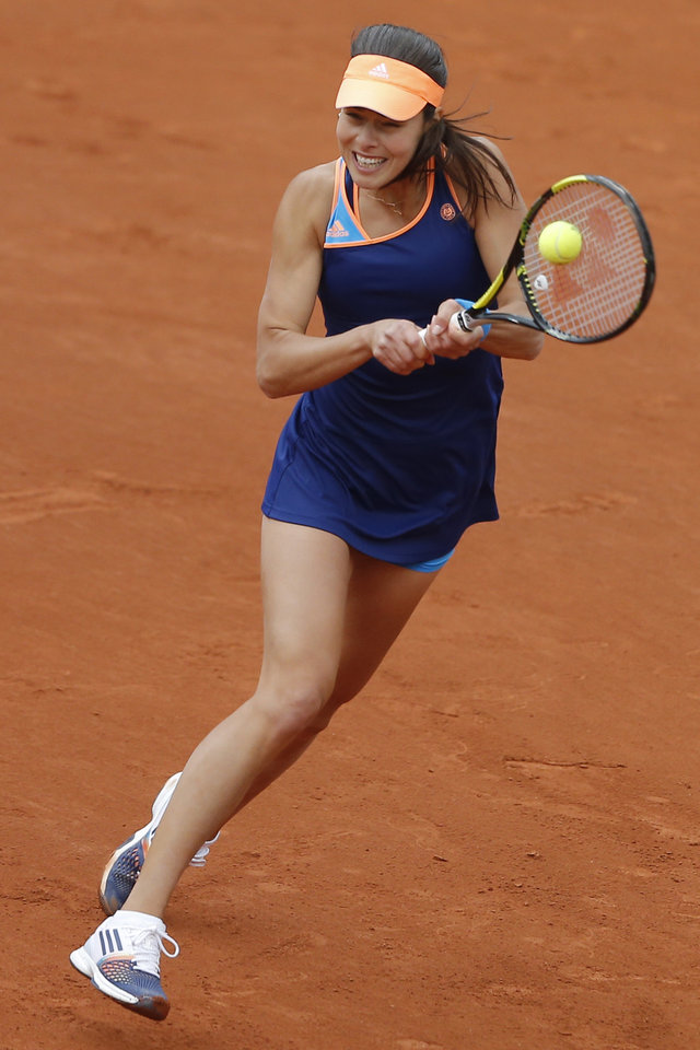 Photo - Serbia's Anna Ivanovic returns the ball during the first round match of the French Open tennis tournament against France's Caroline Garcia at the Roland Garros stadium, in Paris, France, Tuesday, May 27, 2014. (AP Photo/Michel Spingler)