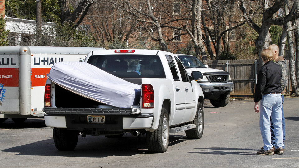 Photo - A mattress fills the bed of this truck as it leaves the parking lot in the back of the SAE house. Parents, friends and fellow students helped members of the SAE  fraternity remove all furniture and personal belongings from the house Tuesday afternoon, March 10, 2015. University officials closed the house and ordered it to be vacated by Tuesday night after a video showing students affiliated with the fraternity uttering offensive racial slurs during a weekend outing.      Photo by Jim Beckel, The Oklahoman