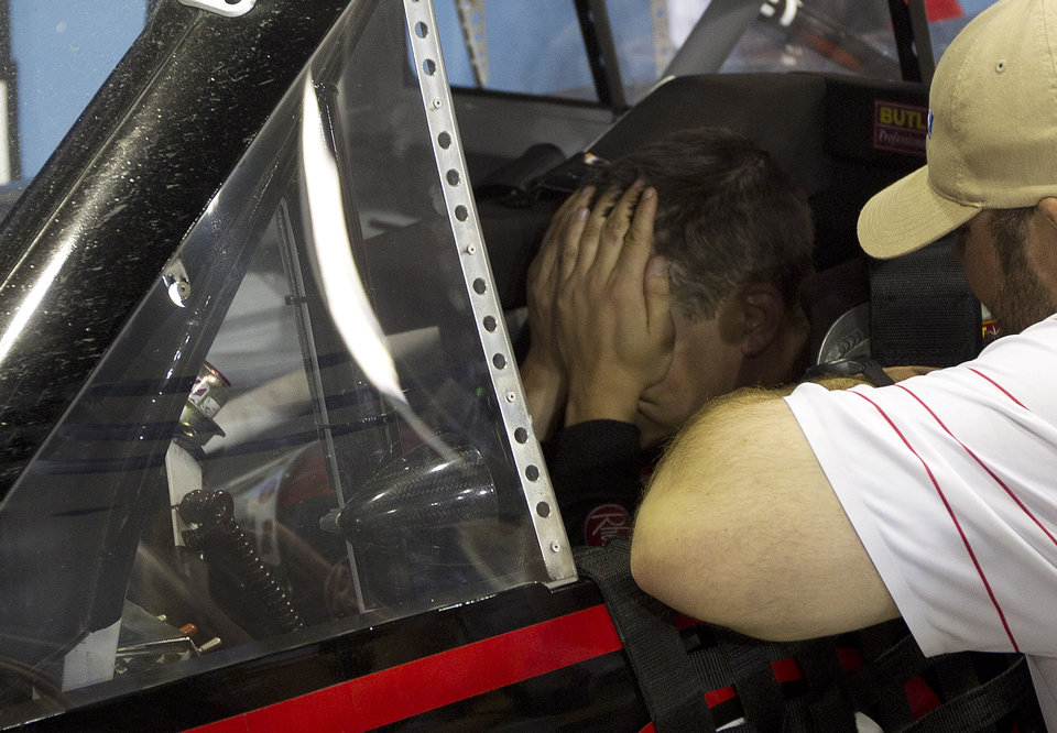 Photo -   Cale Gale reacts in his car after winning the NASCAR Nationwide Truck Series auto race on Friday, Nov. 16 2012, at Homestead-Miami Speedway in Homestead, Fla. (AP Photo/J Pat Carter)