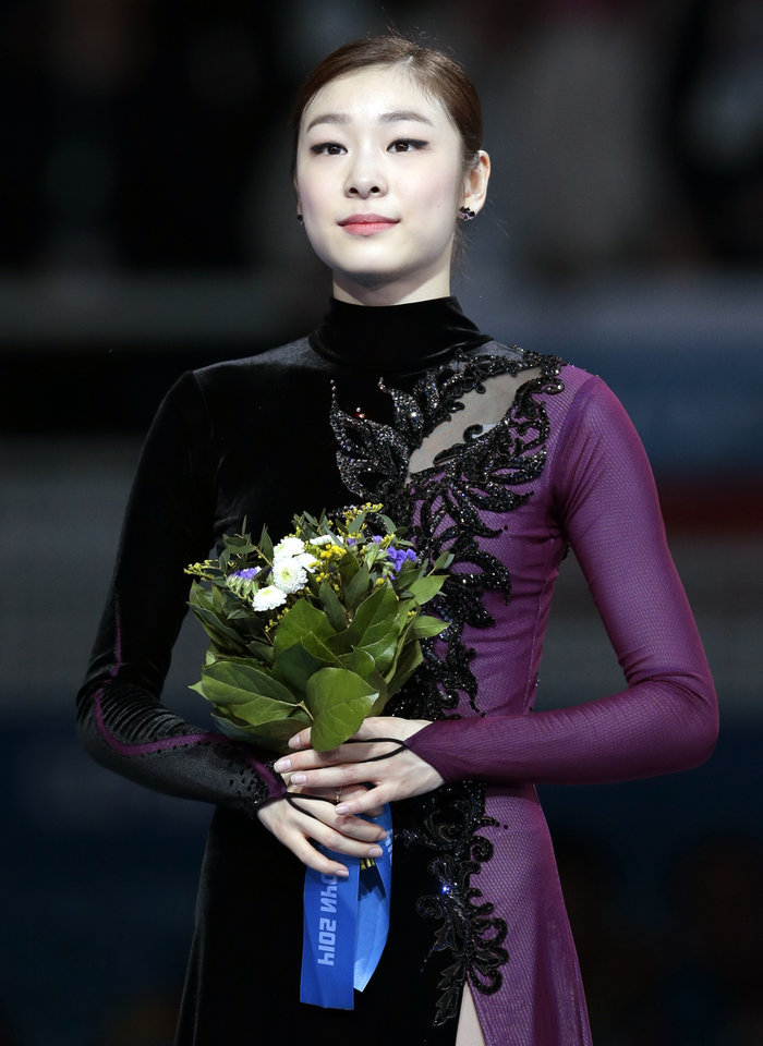 Photo - Yuna Kim of South Korea poses on the podium after placing second in the women's free skate figure skating finals at the Iceberg Skating Palace during the 2014 Winter Olympics, Thursday, Feb. 20, 2014, in Sochi, Russia. (AP Photo/Ivan Sekretarev)