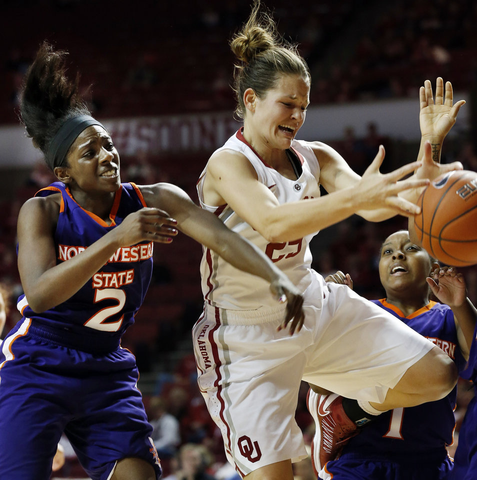 Oklahoma Sooners\' Whitney Hand (25) and Northwestern State Lady Demons\' Tiandra Williams (2) battle for a rebound during the second half as the University of Oklahoma (OU) Sooner women\'s basketball team plays the Northwestern State Lady Demons at the Lloyd Noble Center on Thursday, Nov. 29, 2012 in Norman, Okla. Photo by Steve Sisney, The Oklahoman