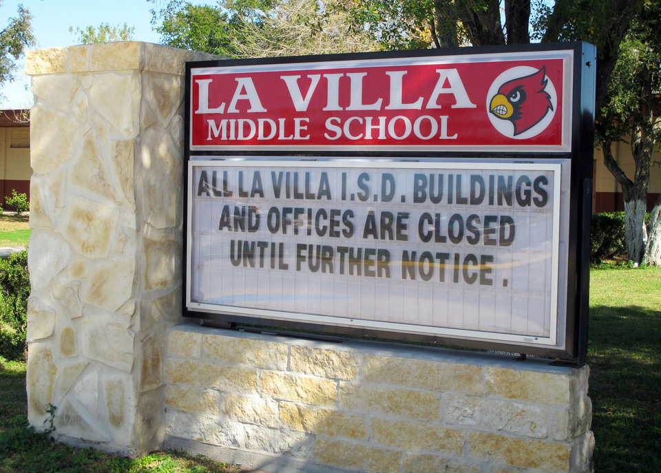 Photo - A sign outside La Villa Middle School tells of the school district's status in La Villa, Texas, Monday, Jan. 13, 2014. Schools in La Villa were supposed to return to classes, but instead a water payment dispute with the city has shut the school down. (AP Photo/Chris Sherman)