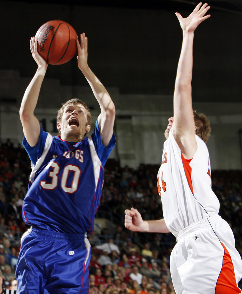 Nathan Beene (30) of Fort Cobb-Broxton shoots the ball as Pete Drouhard (44) of Cheyenne-Reydon defends during the Class A boys basketball state tournament championship game between Cheyenne-Reydon and Fort Cobb-Broxton at State Fair Arena in Oklahoma City, Saturday, March 5, 2011. Fort Cobb-Broxton won, 50-41. Photo by Nate Billings, The Oklahoman