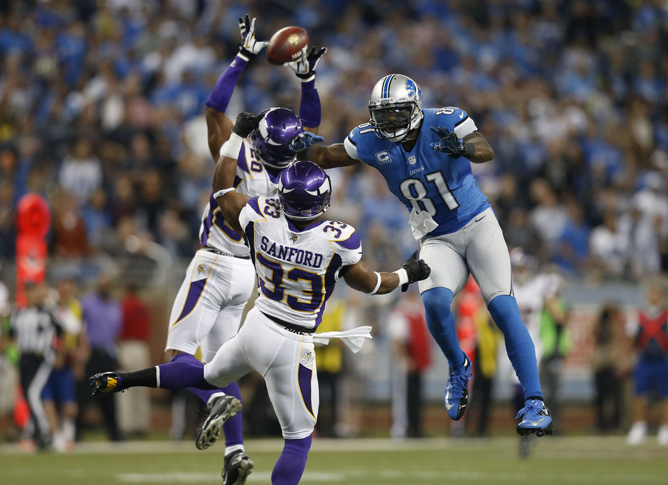 Photo -   **CORRECTS TAGLINE TO RICK OSENTOSKI** Minnesota Vikings cornerback Chris Cook (20) and strong safety Jamarca Sanford (33) interfere with Detroit Lions wide receiver Calvin Johnson (81) during the first quarter of an NFL football game at Ford Field in Detroit, Sunday, Sept. 30, 2012. (AP Photo/Rick Osentoski)