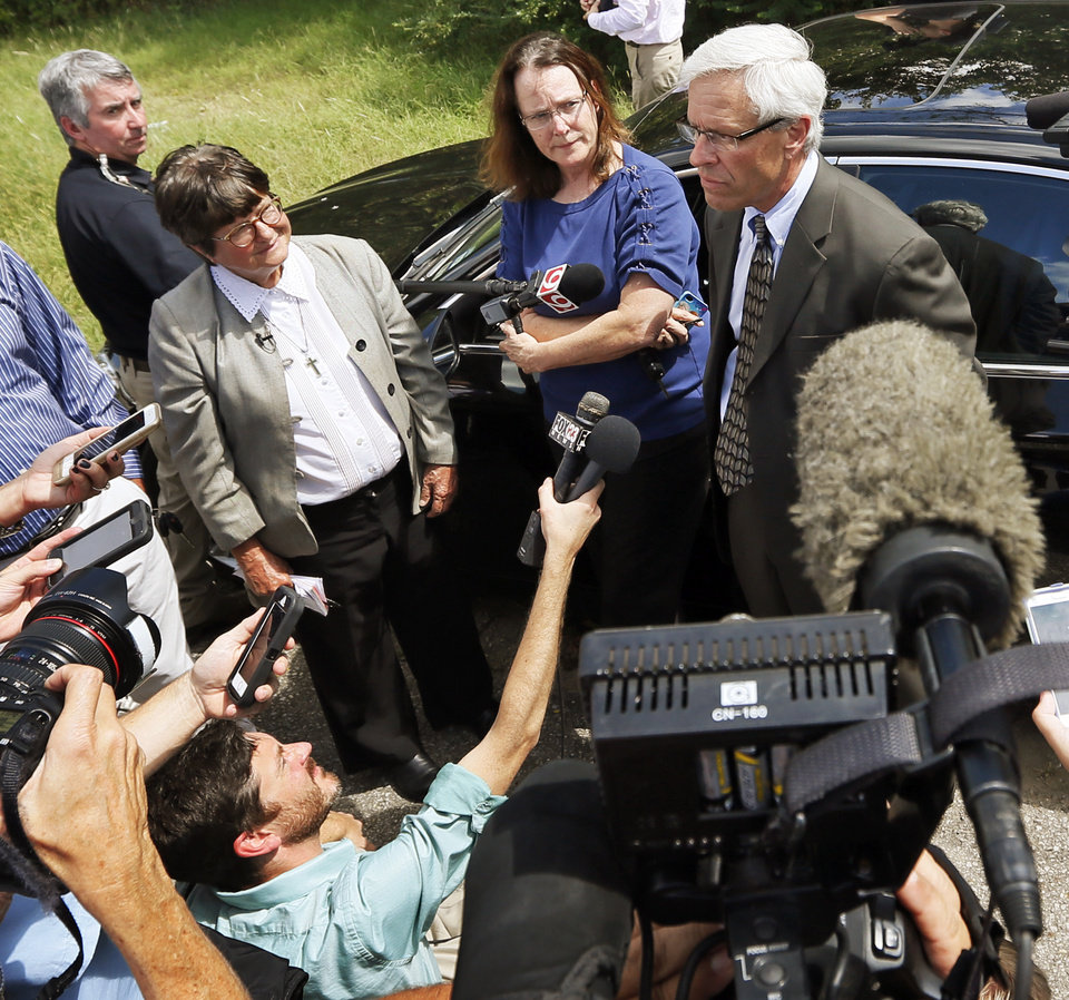 Photo - From left, Sister Helen Prejean, Kathleen Lord and Don Knight speak to the press after a two-week stay of execution was announced for Richard Eugene Glossip, outside the Oklahoma State Penitentiary in McAlester, Okla., Wednesday, Sept. 16, 2015. Prejean is an advocate for Glossip's innocence. Lord and Knight are from Glossip's legal team. Photo by Nate Billings, The Oklahoman