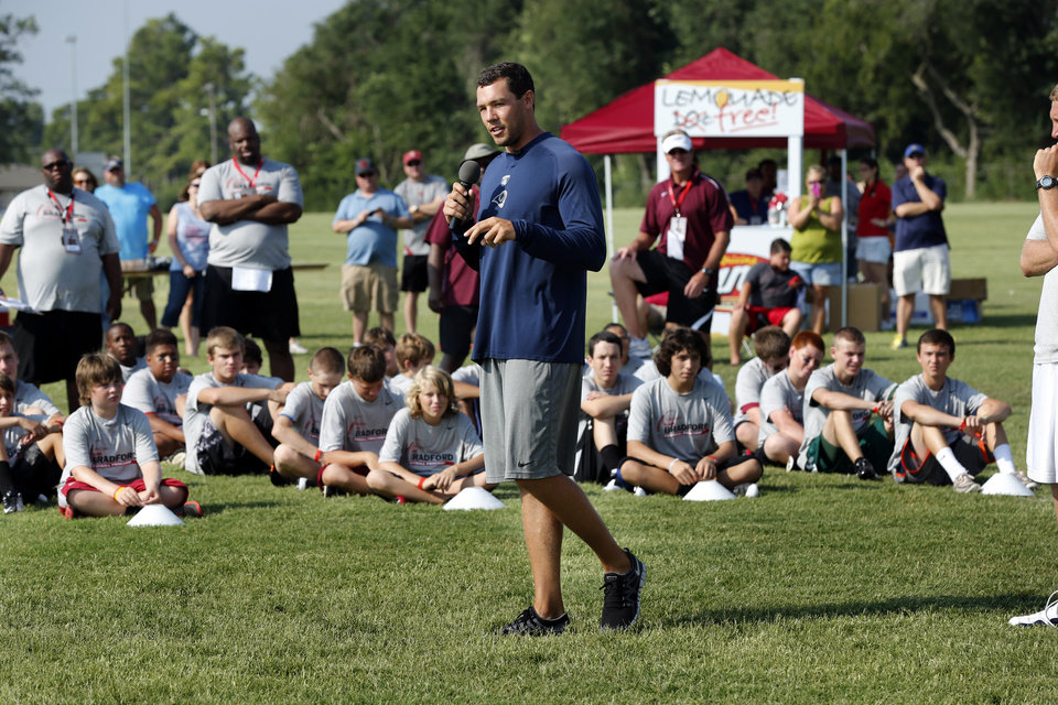 Sam Bradford works with campers during his football camp on the campus of the University of Oklahoma on Tuesday, July 10, 2012, in Norman, Okla. 
