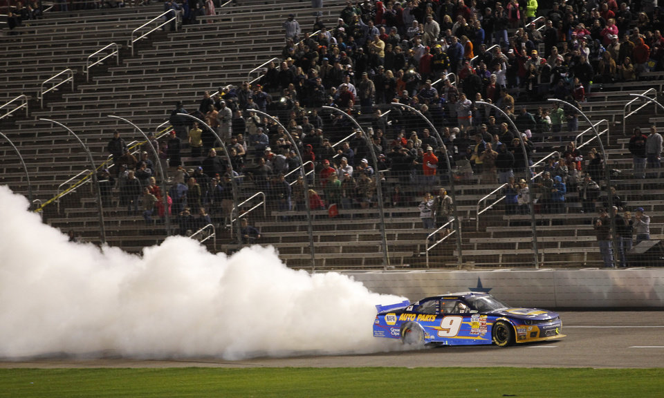 Photo - Chase Elliott does a burnout after winning the NASCAR Nationwide Series auto race at Texas Motor Speedway in Fort Worth, Texas, Friday, April 4, 2014. (AP Photo/Mike Stone)