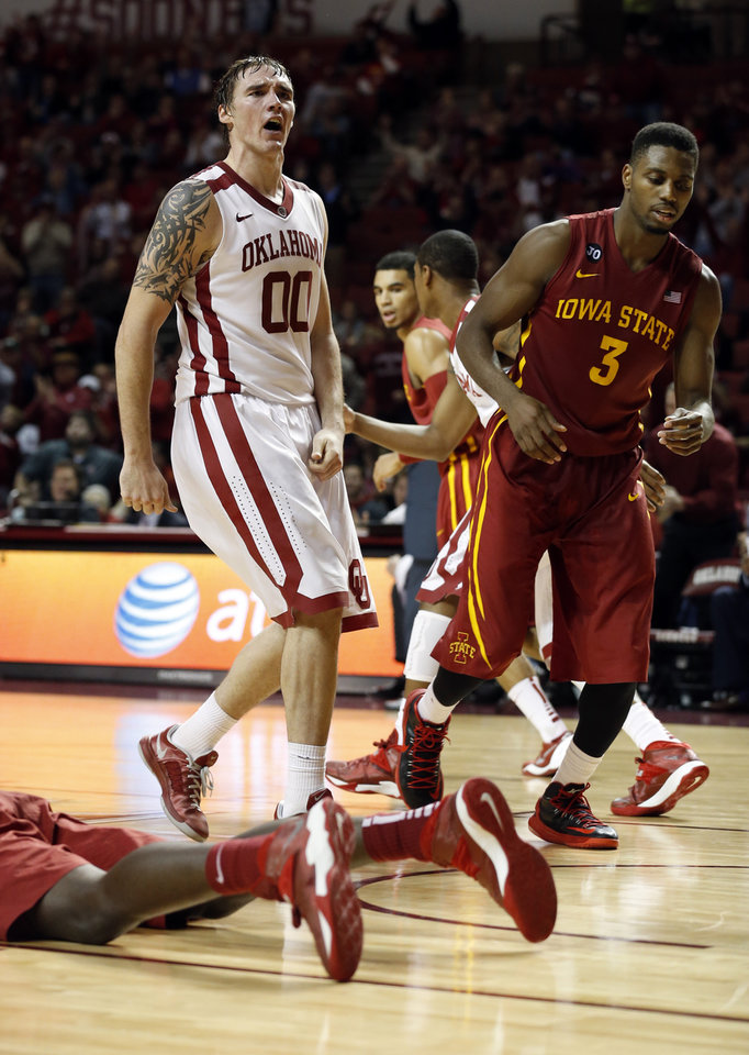 Photo - Oklahoma Sooner's Ryan Spangler reacts after being fouled on a put back shot as the University of Oklahoma Sooners (OU) men defeat the Iowa State Cyclones (ISU) 87-82 in NCAA, college basketball at The Lloyd Noble Center on Saturday, Jan. 11, 2014  in Norman, Okla. Photo by Steve Sisney, The Oklahoman