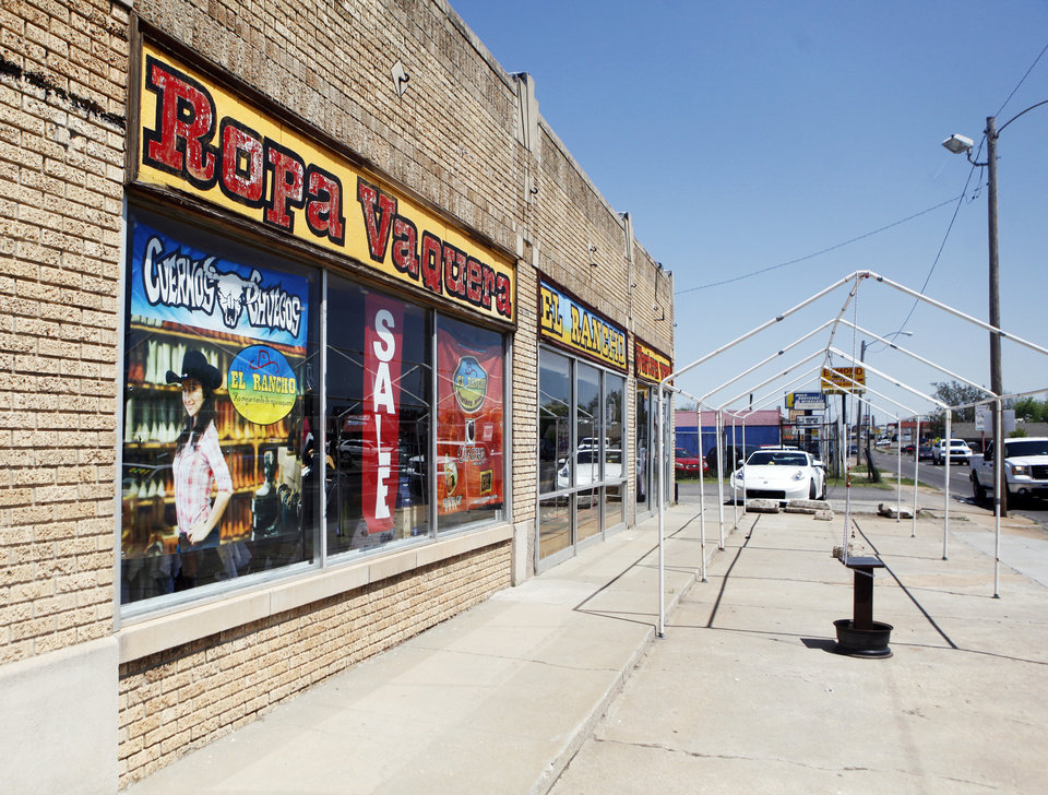 Photo -  A storefront on SW 29 is seen Tuesday. The street will be closed Sunday afternoon from Western to Walker for a street festival. Photo by KT King, The Oklahoman   KT King -