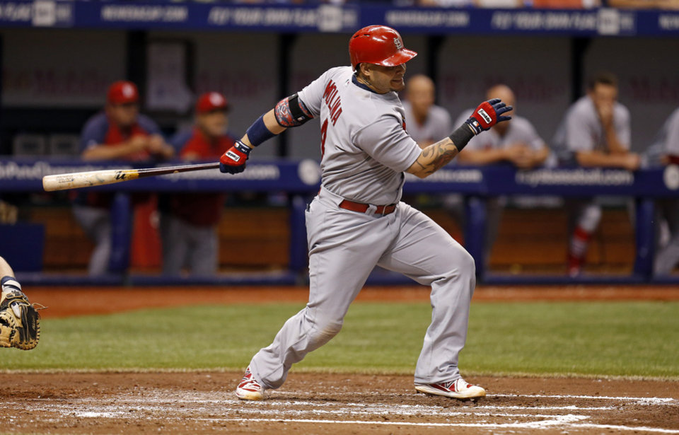 Photo - St. Louis Cardinals' Yadier Molina follows through on a single that scored two runs during the third inning of a baseball game against the Tampa Bay Rays Wednesday, June 11, 2014, in St. Petersburg, Fla. (AP Photo/Mike Carlson)