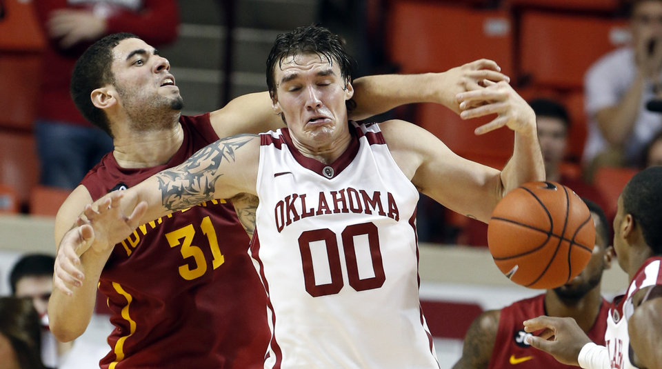 Oklahoma Sooner's Ryan Spangler (00) and Iowa State Cyclone's Georges Niang (31) fight for a rebound as the University of Oklahoma Sooners (OU) men defeat the Iowa State Cyclones (ISU) 87-82 in NCAA, college basketball at The Lloyd Noble Center on Saturday, Jan. 11, 2014  in Norman, Okla. Photo by Steve Sisney, The Oklahoman