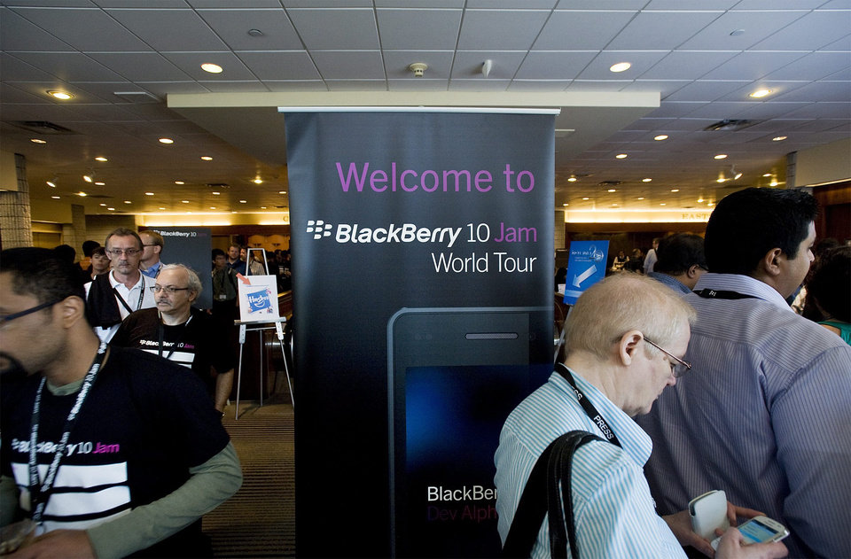 Photo -   Guests are seen during Research In Motion Ltd.'s Blackberry 10 Jam World Tour in Toronto on Thursday June 21, 2012. The first BlackBerry device running RIM's new operating software will not have a physical keyboard, only a touch-screen one. RIM is expected to start selling BlackBerry 10 touch-screen devices this year. (AP Photo/The Canadian Press, Aaron Vincent Elkaim)