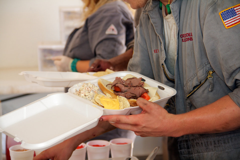 Oilfield workers enjoy a deli bar onsite at a well near Sweetwater. The meal was prepared by Erick-based Somekinda Catering, which provides food to oilfield workers throughout western Oklahoma and the Texas panhandle. <strong>photo by Adam Wilmoth</strong>