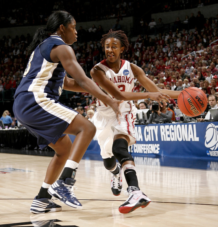 OU's Danielle Robinson drives around Pittsburgh's Xenia Stewart during the NCAA women's basketball tournament game between Oklahoma and Pittsburgh at the Ford Center in Oklahoma City, Sunday, March 29, 2009.  PHOTO BY BRYAN TERRY, THE OKLAHOMAN