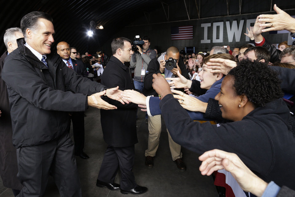 Republican presidential candidate and former Massachusetts Gov. Mitt Romney greets supporters as he campaigns at Dubuque Regional Airport, in Dubuque, Iowa, Saturday, Nov. 3, 2012. (AP Photo/Charles Dharapak)