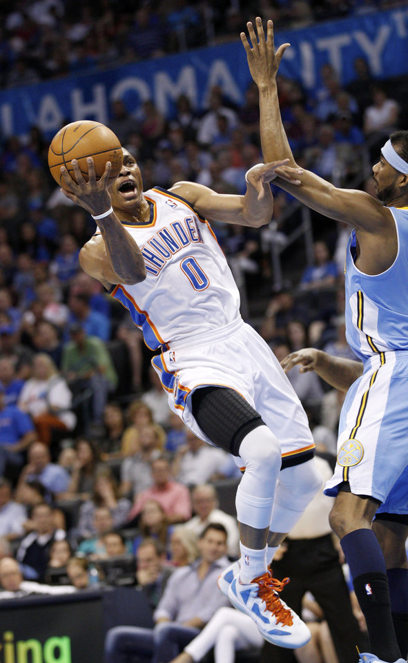 Photo -   Oklahoma City Thunder guard Russell Westbrook (0) shoots in front of Denver Nuggets guard Ty Lawson, right, during the first quarter of an NBA basketball game in Oklahoma City, Wednesday, April 25, 2012. (AP Photo/Sue Ogrocki)