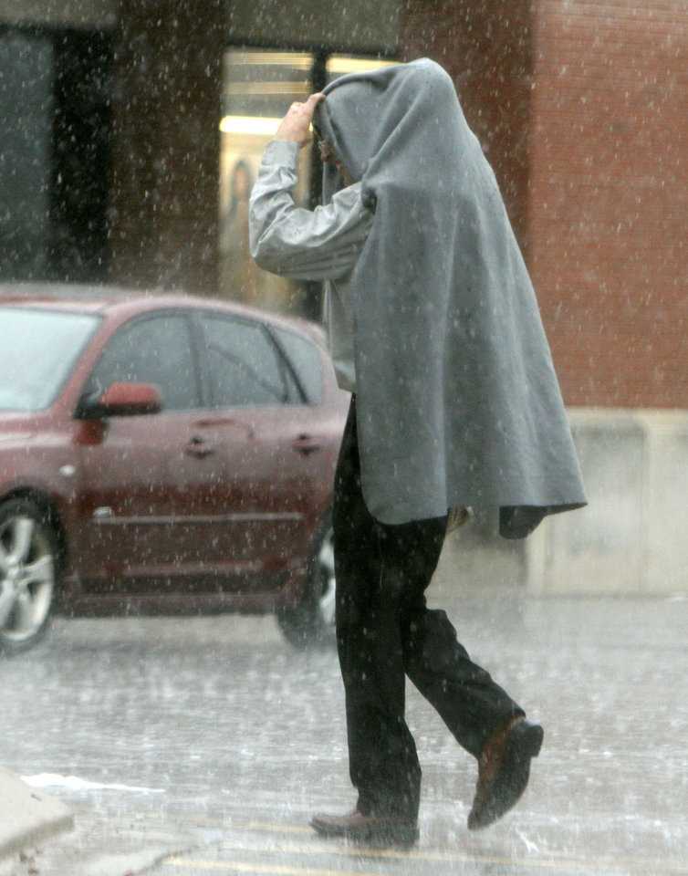 A shopper walks through a heavy rain as he enters the Homeland store on North May Ave. and Britton Road in Oklahoma City, OK, Saturday, August 18, 2012,  By Paul Hellstern, The Oklahoman