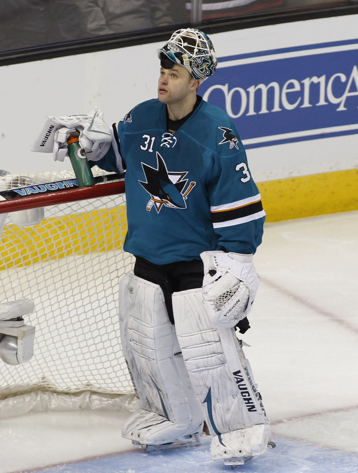 Photo - San Jose Sharks goalie Antti Niemi, looks up after giving up a goal to the Philadelphia Flyers during the third period of an NHL hockey game, Monday, Feb. 3, 2014, in San Jose, Calif. (AP Photo/George Nikitin)