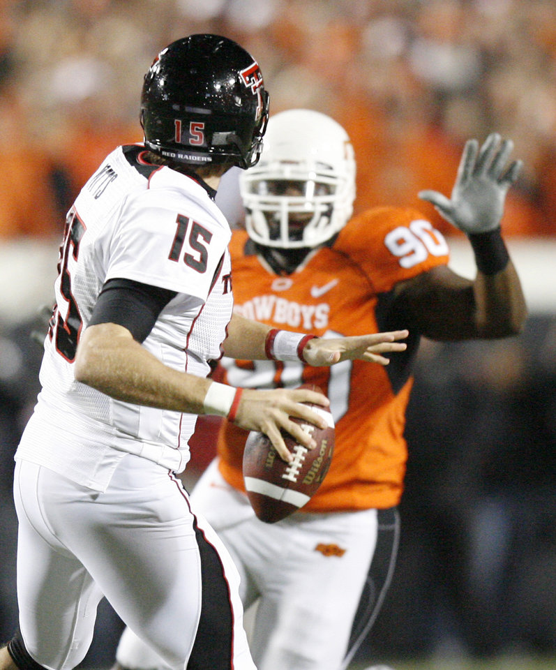 Photo - Cowboy Swanson Miller (90) puts pressure on Taylor Potts (15) during the college football game between Oklahoma State University (OSU) and Texas Tech University at Boone Pickens Stadium in Stillwater, Okla. Saturday, Nov. 14, 2009. Photo by Sarah Phipps, The Oklahoman