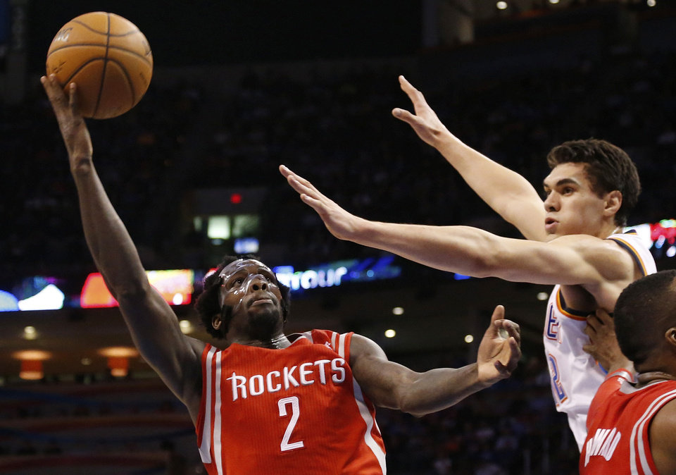 Photo - Houston Rockets guard Pat Beverley (2) shoots in front of Oklahoma City Thunder center Steven Adams duirng the second quarter of an NBA basketball game in Oklahoma City, Tuesday, March 11, 2014. (AP Photo/Sue Ogrocki)