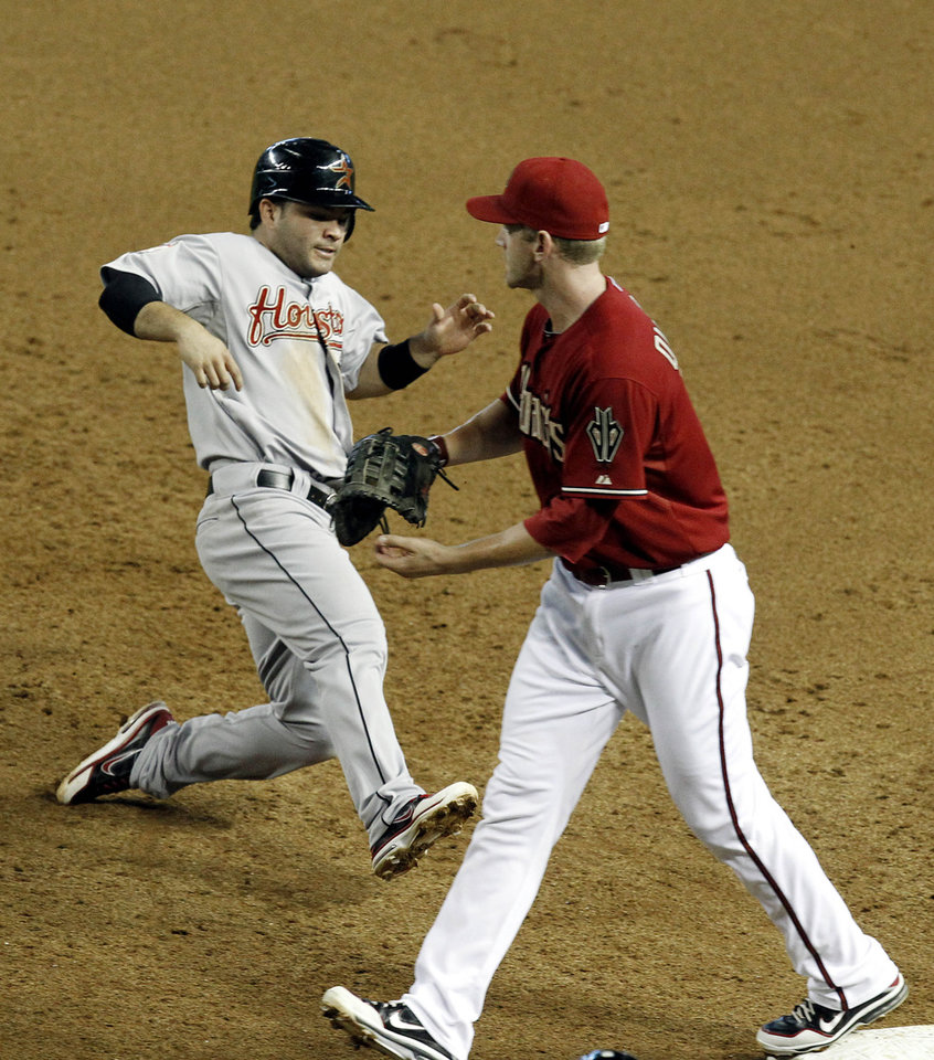 Photo -   Houston Astros' Jose Altuve, left, gets doubled up at first base by Arizona Diamondbacks' Lyle Overbay in the third inning during a baseball game on Sunday, July 22, 2012, in Phoenix. (AP Photo/Ross D. Franklin)