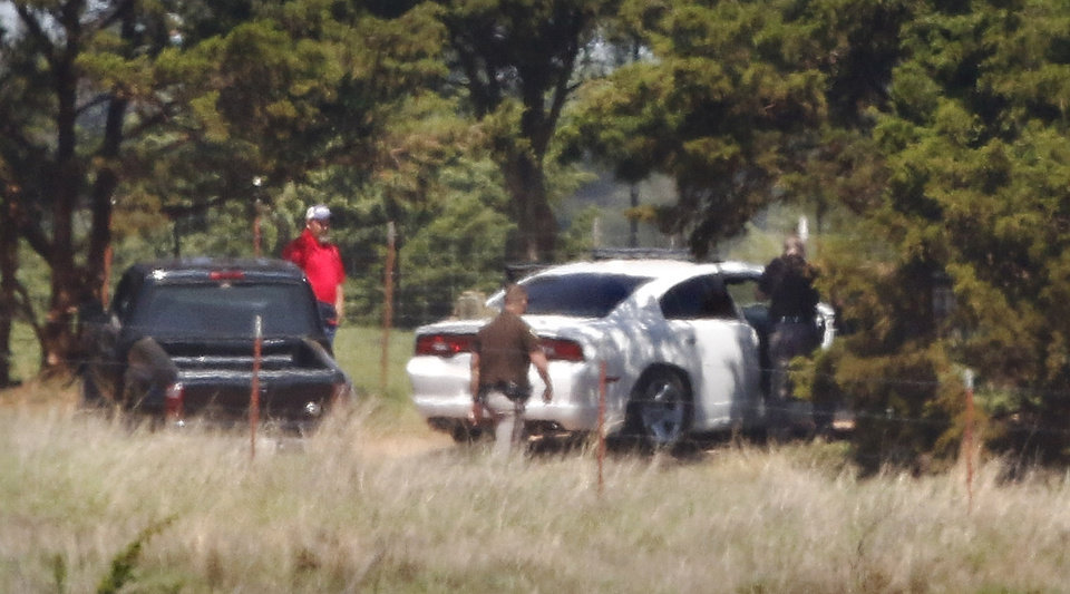 Photo - Law officers conduct a ground search for suspect in the shooting death of a deputy. The man accused of fatally shooting a Logan County sheriff's deputy Tuesday, April 18, 2017,  and leading authorities on a manhunt near Langston, is in custody, according to Logan County Sheriff Damon Devereaux.  Authorities identified Nathan Aaron LeForce, 45, as the person who shot Logan County Sheriff's Deputy David Wade while Wade was serving an eviction notice at a home in Mulhall.     Photo by Jim Beckel, The Oklahoman