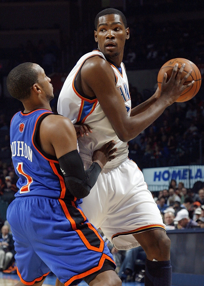 Photo - Oklahoma City's Kevin Durant (35) looks to get the ball past Chris Duhon (1) of New York during the NBA basketball game between the Oklahoma City Thunder and the New York Knicks at the Ford Center in Oklahoma City, January 11, 2010. Photo by Nate Billings, The Oklahoman ORG XMIT: KOD