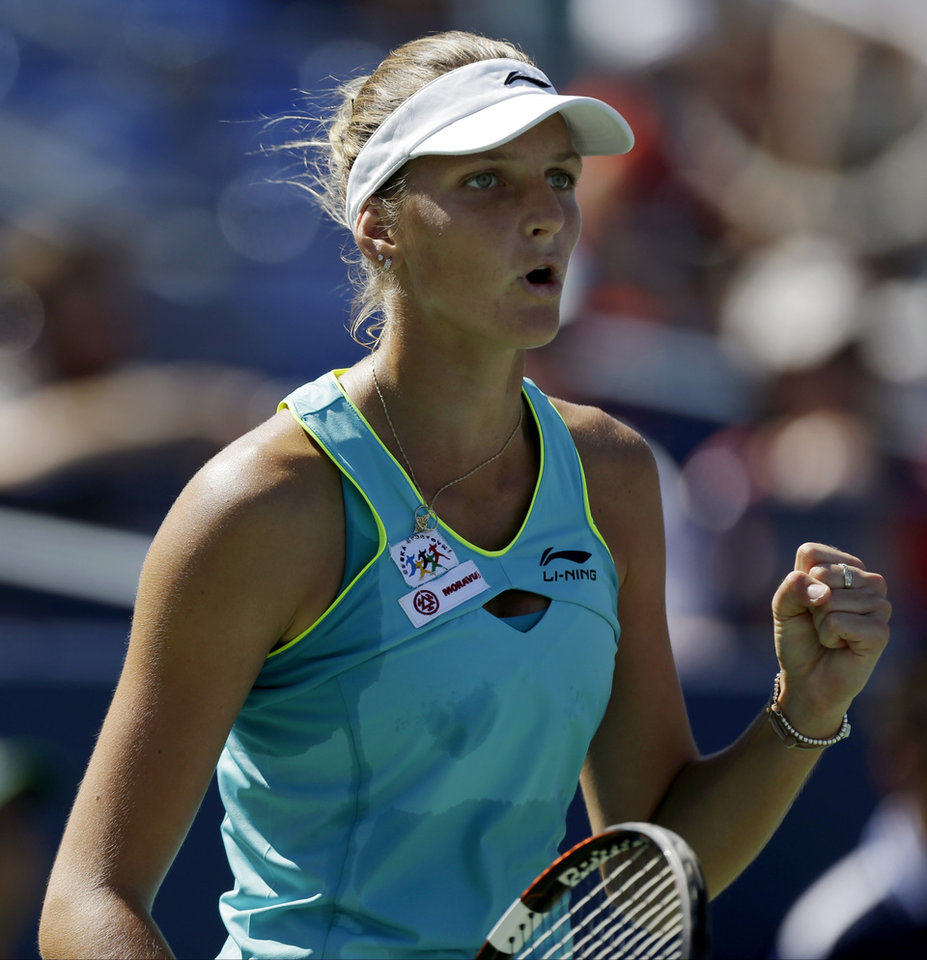 Photo - Kirolina Pliskova, of the Czech Republic, reacts after a point against Ana Ivanovic, of Serbia, during the second round of the 2014 U.S. Open tennis tournament, Thursday, Aug. 28, 2014, in New York. (AP Photo/Frank Franklin II)