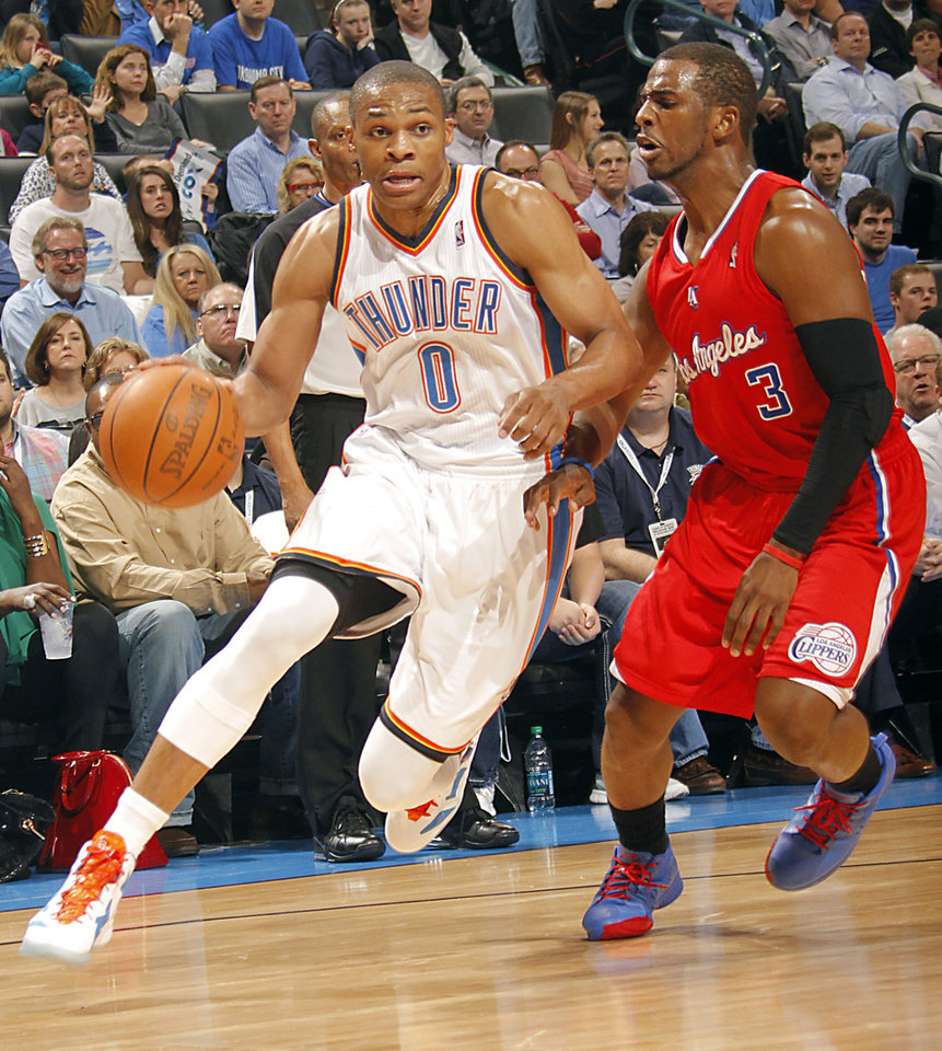 Oklahoma City Thunder point guard Russell Westbrook (0) drives past Los Angeles Clippers point guard Chris Paul (3) during the NBA basketball game between the Oklahoma City Thunder and the Los Angeles Clippers at Chesapeake Energy Arena on Wednesday, March 21, 2012 in Oklahoma City, Okla.  Photo by Chris Landsberger, The Oklahoman