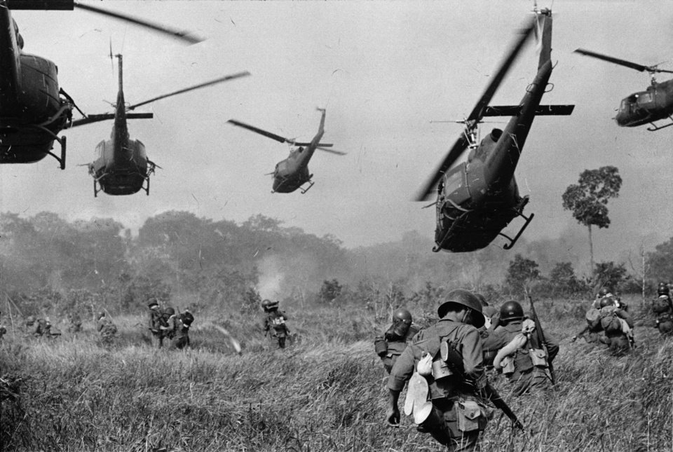 Photo -   FILE - In this March 1965 file photo shot by Associated Press photographer Horst Faas, hovering U.S. Army helicopters pour machine gun fire into the tree line to cover the advance of South Vietnamese ground troops in an attack on a Viet Cong camp 18 miles north of Tay Ninh, Vietnam, northwest of Saigon near the Cambodian border. Faas, a prize-winning combat photographer who carved out new standards for covering war with a camera and became one of the world's legendary photojournalists in nearly half a century with The Associated Press, died Thursday May 10, 2012. He was 79. (AP Photo/Horst Faas, File)