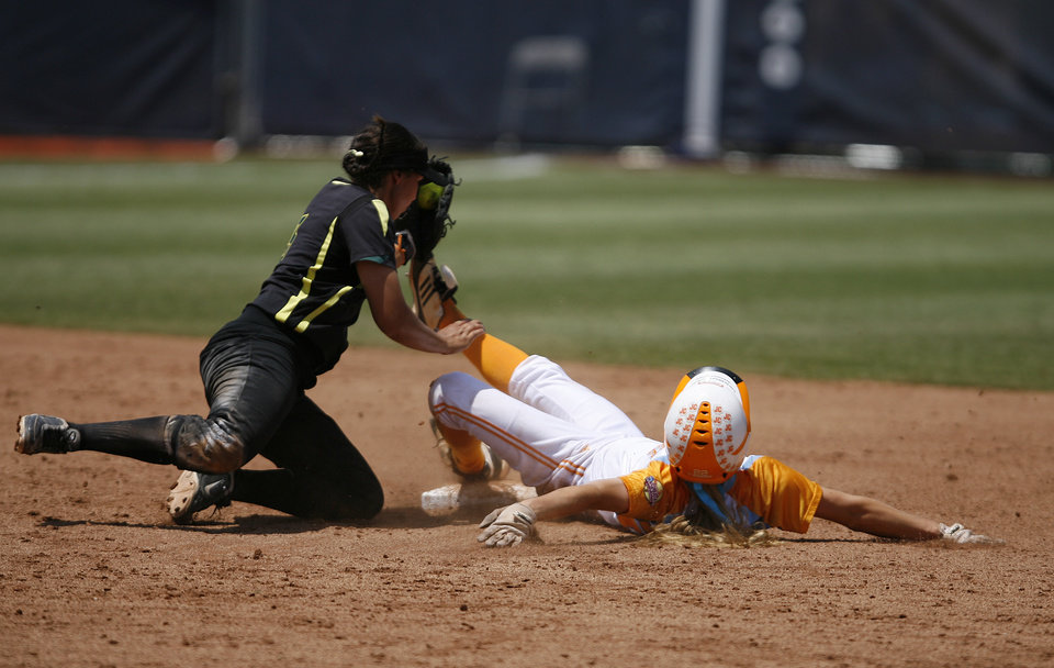 Tennessee\'s Ashley Andrew\'s (22) slides into second base past Oregon\'s Kaylan Howard (3) during a Women\'s College World Series game between Tennessee and Oregon at ASA Hall of Fame Stadium in Oklahoma City, Saturday, June 2, 2012. Photo by Garett Fisbeck, The Oklahoman