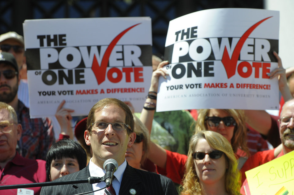 Photo -   State Rep. Mark Ferrandino addresses the crowd during a rally supporting civil unions at the Denver City and County Building in Denver, Thursday, May 3, 2012. The rally took place prior to the House Judiciary Committee hearing on Senate Bill 2 at the State Capitol. The Colorado Civil Union Act recently passed the Senate with bipartisan support. The bill would allow same sex couple to enter into civil union. (AP Photo/The Denver Post, Craig F. Walker) MAGS OUT; TV OUT; INTERNET OUT