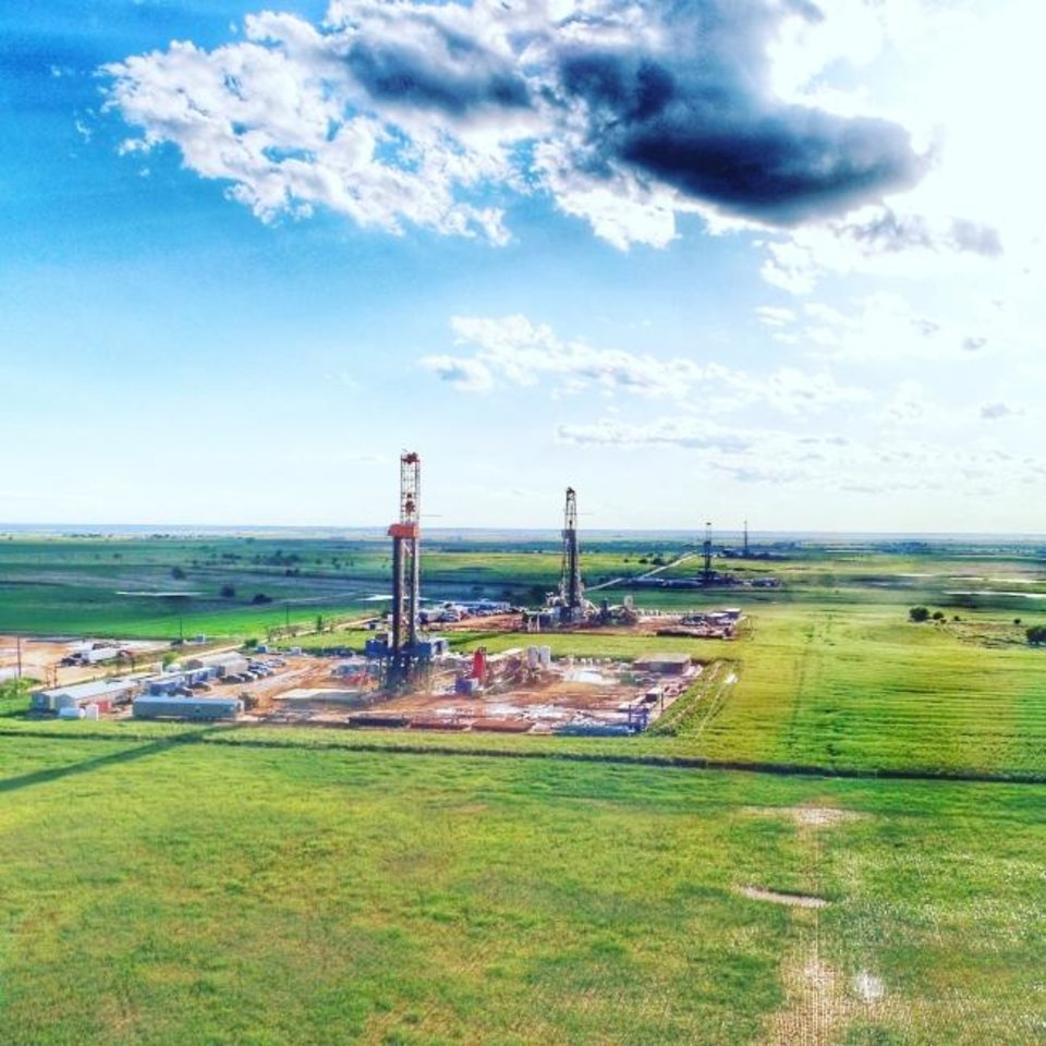 Photo -  Rigs drill wells as part of an Ovintiv cube development in the Anadarko Basin. [PROVIDED]