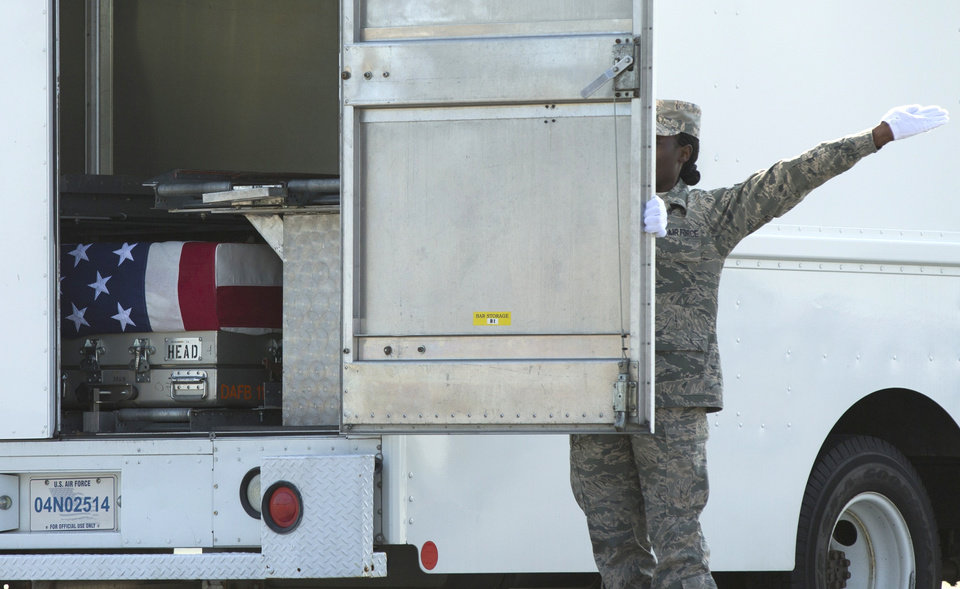 Photo - The casket of Army Maj. Gen. Harold Greene is readied for transfer, Thursday, Aug. 7, 2014, at Dover Air Force Base, Del. Greene was shot to death Tuesday when a gunman dressed as an Afghan soldier turned on ISAF troops, wounding about 15 including a German general and two Afghan generals. He is the highest-ranking U.S. military officer to be killed in either of America's post-9/11 wars. (AP Photo/Evan Vucci)