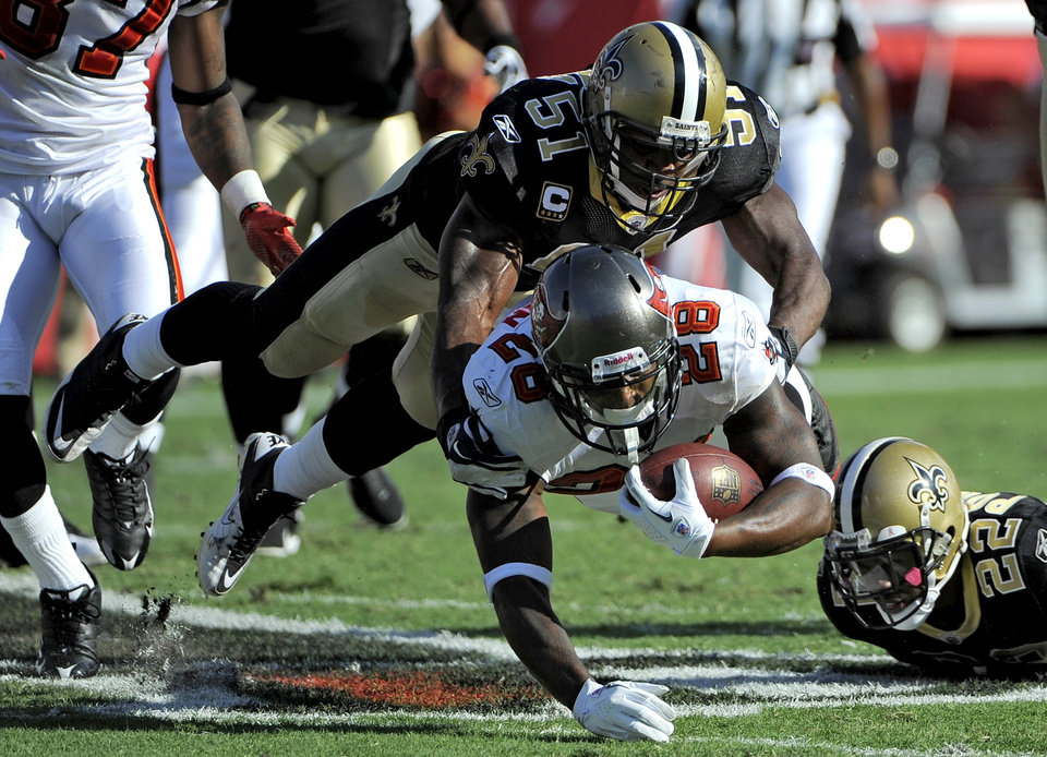 Photo -   FILE - This Oct. 16, 2011 file photo shows New Orleans Saints linebacker Jonathan Vilma (51) taking down Tampa Bay Buccaneers running back Kregg Lumpkin (28) during the second quarter of an NFL football game, in Tampa, Fla. Vilma has been suspended without pay for the entire 2012 season by the NFL, one of four players punished for participating in a pay-for-pain bounty system. NFL Commissioner Roger Goodell's ruling was announced Wednesday, May 2, 2012 . (AP Photo/Brian Blanco, File)