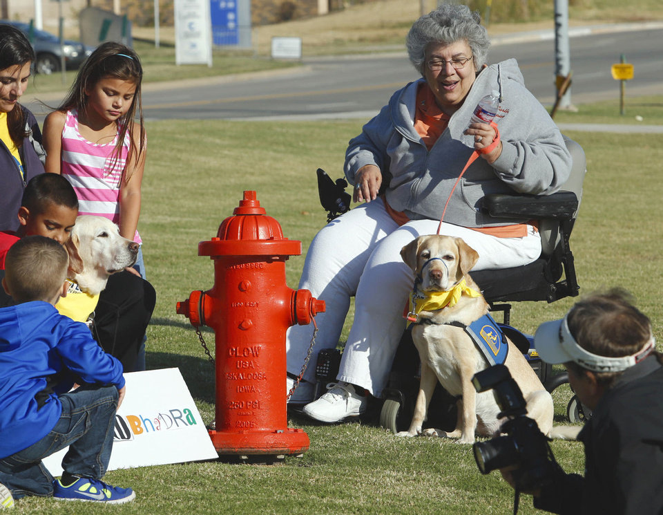 Photo - Dawn Ramsey, (right) event coordinator, and her hearing assistance dog Penela, take part in DogFest Walk 'n Roll Oklahoma City to benefit Canine Companions on Saturday, Oct. 12, 2013 in Oklahoma City, Okla.  Photo by Steve Sisney, The Oklahoman