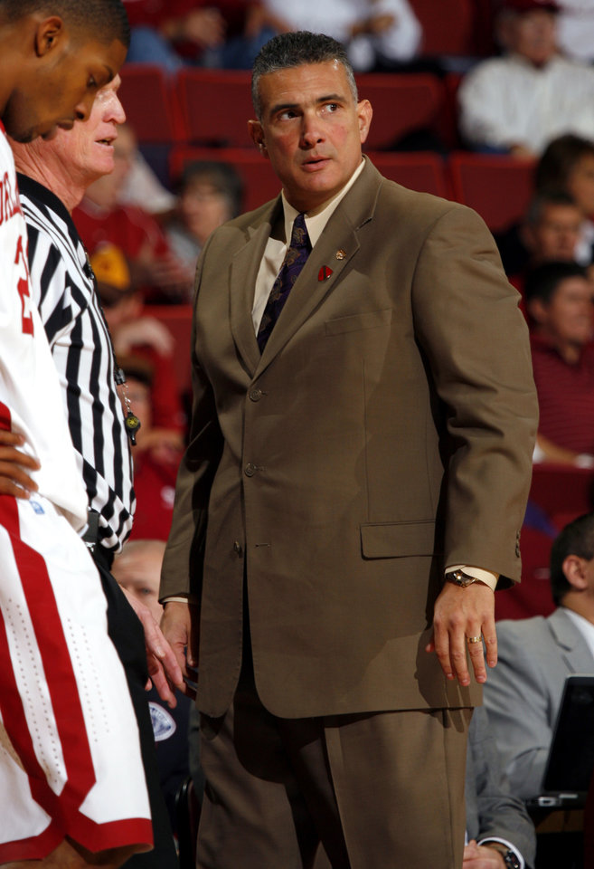 Photo - Kansas State Wildcats head coach Frank Martin glares at his team in the first half as the University of Oklahoma (OU) Sooners play the Kansas State Wildcats in men's college basketball at the Lloyd Noble Center on Saturday, Jan. 14, 2012, in Norman, Okla.  Photo by Steve Sisney, The Oklahoman