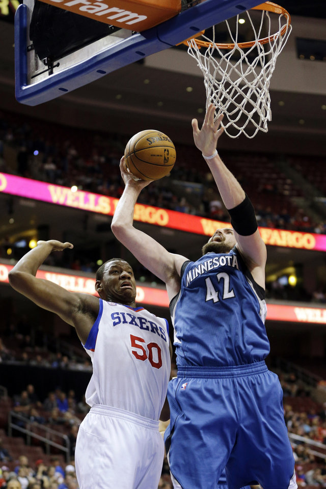 Photo - Minnesota Timberwolves' Kevin Love (42) shoots against Philadelphia 76ers' Lavoy Allen (50) in the first half of an NBA basketball game, Tuesday, Dec. 4, 2012, in Philadelphia. (AP Photo/Matt Slocum)