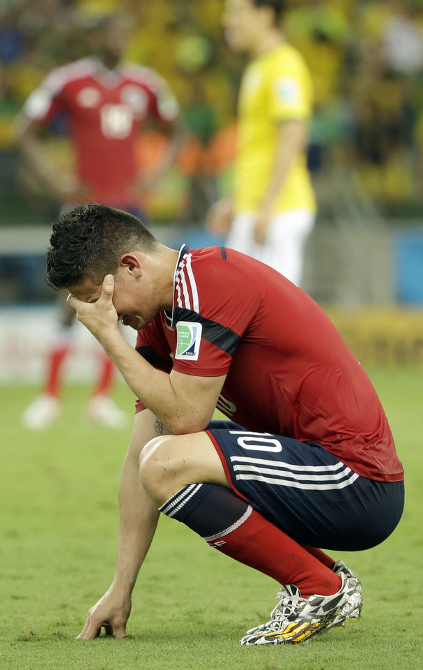 Photo - Colombia's James Rodriguez reacts at the end of the World Cup quarterfinal soccer match between Brazil and Colombia at the Arena Castelao in Fortaleza, Brazil, Friday, July 4, 2014. Brazil won 2-1 to reach the semifinals.(AP Photo/Hassan Ammar)