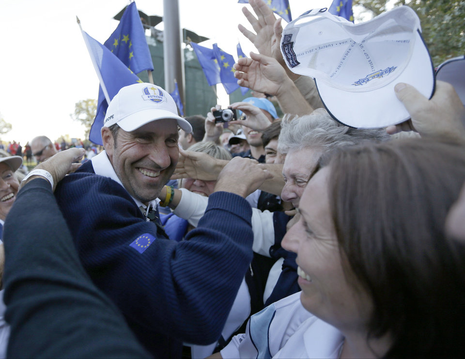 Photo - European team captain Jose Maria Olazabal celebrates after winning the Ryder Cup PGA golf tournament Sunday, Sept. 30, 2012, at the Medinah Country Club in Medinah, Ill. (AP Photo/David J. Phillip)  ORG XMIT: PGA226