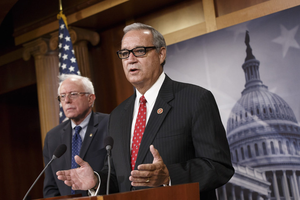 Photo - House Veterans' Affairs Committee Chairman Rep. Jeff Miller, R-Fla.,  joined by Senate Veterans' Affairs Committee Chairman Sen. Bernie Sanders, I-Vt., left,  speaks during a news conference on Capitol Hill, in Washington, Monday, July 28, 2014, about a bipartisan deal to improve veterans' health care that would authorize at least $17 billion to fix the health program scandalized by long patient wait times and falsified records covering up delays.  (AP Photo/J. Scott Applewhite)