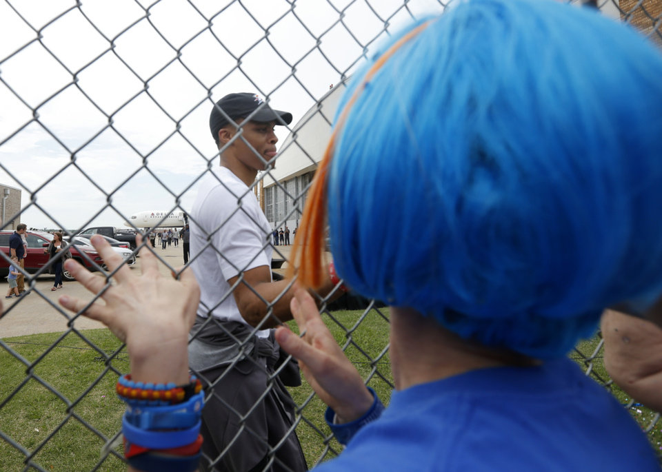 Photo - Oklahoma City's Russell Westbrook (0) greets fans after the Oklahoma City Thunder arrive home from the NBA Western Conference Finals at Will Rogers Airport in Oklahoma City, Tuesday, May 31, 2016. Photo by Sarah Phipps, The Oklahoman