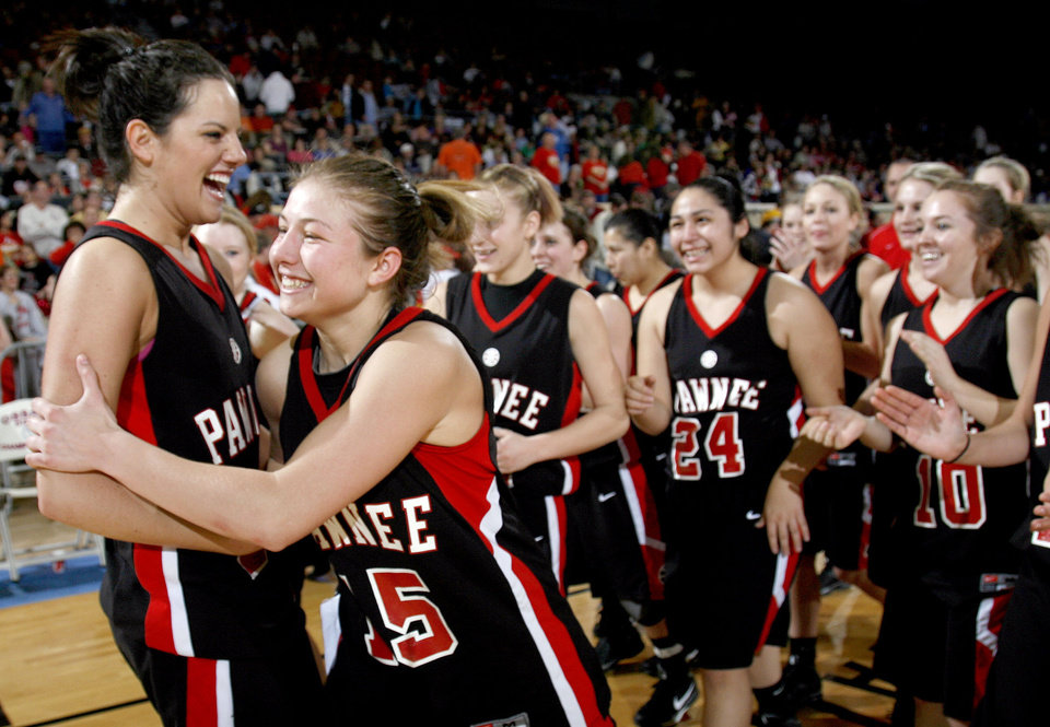 Photo - Pawnee's Whitney LeGrand (23) and Britney Morgan (15) celebrate the Lady Bears' win over Dale in the girls 2A semifinal at the State Fair Arena, Friday, March 13, 2009, in Oklahoma City. PHOTO BY SARAH PHIPPS, THE OKLAHOMAN
