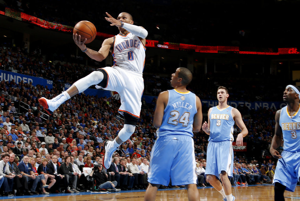 Oklahoma City\'s Russell Westbrook (0) goes past Denver\'s Andre Miller (24) , Danilo Gallinari (8), and Ty Lawson (3) during an NBA basketball game between the Oklahoma City Thunder and the Denver Nuggets at Chesapeake Energy Arena in Oklahoma City, Tuesday, March 19, 2013. Denver won 114-104. Photo by Bryan Terry, The Oklahoman
