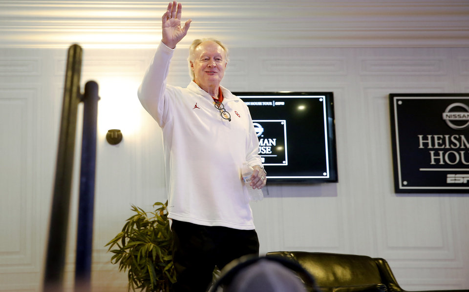 Photo - Steve Owens waves to the crowd inside the  Heisman House before a college football game between the University of Oklahoma Sooners (OU) and the West Virginia Mountaineers at Gaylord Family-Oklahoma Memorial Stadium in Norman, Okla, Saturday, Oct. 19, 2019. [Bryan Terry/The Oklahoman]