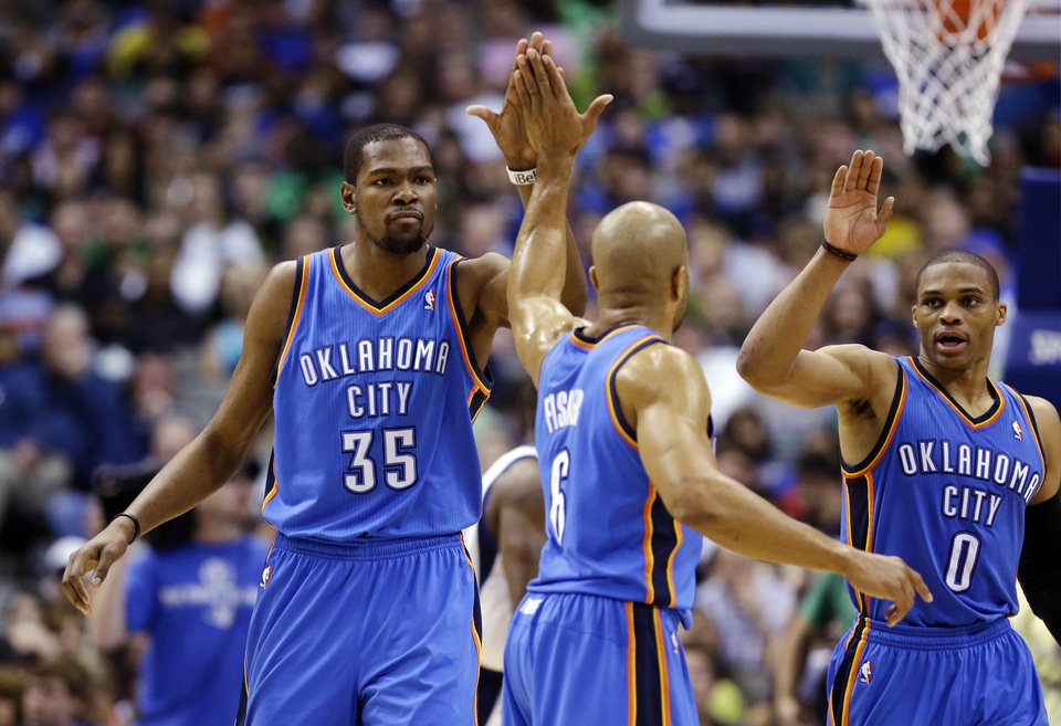 Oklahoma City Thunder\'s Kevin Durant (35) celebrates with Derek Fisher (6) and Russell Westbrook (0) during the first half of an NBA basketball game against the Dallas Mavericks, Sunday, March 17, 2013, in Dallas. The Thunder won 107-101. (AP Photo/LM Otero) ORG XMIT: DNA112