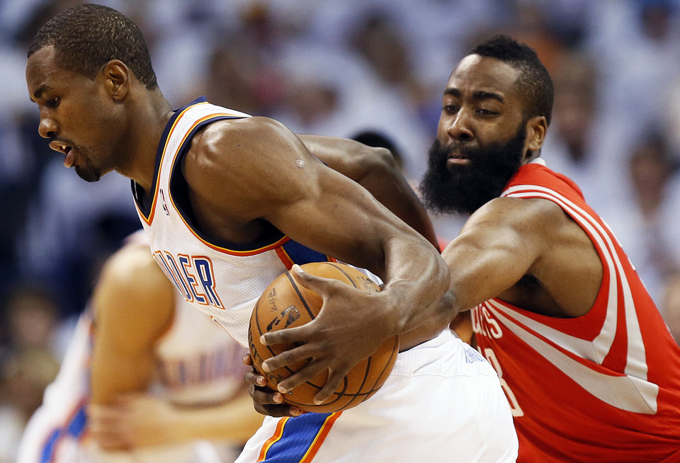 Photo - Houston's James Harden (13) tries to steal the ball from Oklahoma City's Serge Ibaka (9) during Game 2 in the first round of the NBA playoffs between the Oklahoma City Thunder and the Houston Rockets at Chesapeake Energy Arena in Oklahoma City, Wednesday, April 24, 2013. Photo by Nate Billings, The Oklahoman