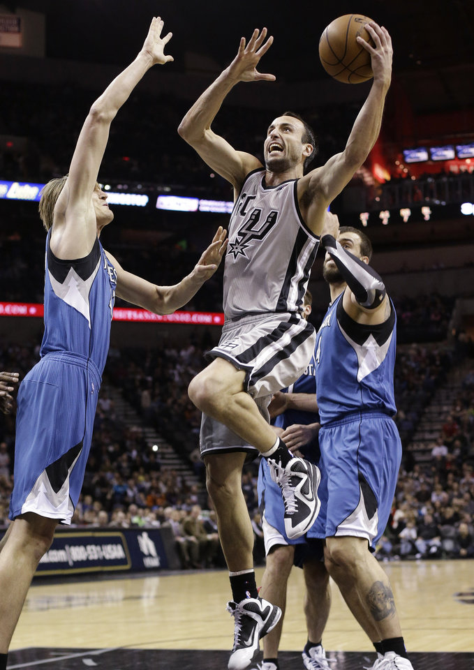 San Antonio Spurs\' Manu Ginobili, center, of Argentina, shoots over Minnesota Timberwolves\' Andrei Kirilenko, left, of Russia, during the first quarter of an NBA basketball game on Sunday, Jan. 13, 2013, in San Antonio. (AP Photo/Eric Gay)