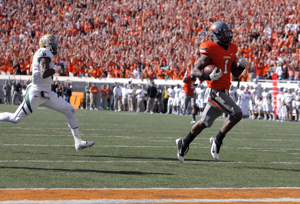 Photo - Oklahoma State's Joseph Randle (1) scores a touchdown as Baylor's Ahmad Dixon (6) chases him down during a college football game between the Oklahoma State University Cowboys (OSU) and the Baylor University Bears (BU) at Boone Pickens Stadium in Stillwater, Okla., Saturday, Oct. 29, 2011. Photo by Sarah Phipps, The Oklahoman