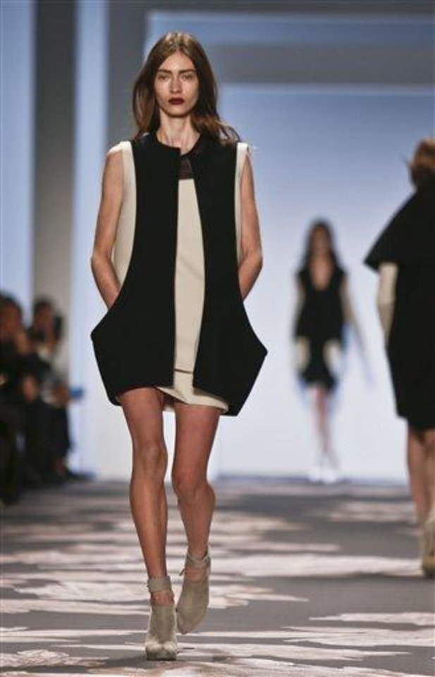 Photo - Fashion from the Fall 2013 Vera Wang collection is modeled on Tuesday, Feb. 12, 2013 in New York.  (AP Photo/Bebeto Matthews)